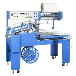 auto sealing and hot shrink packing machine